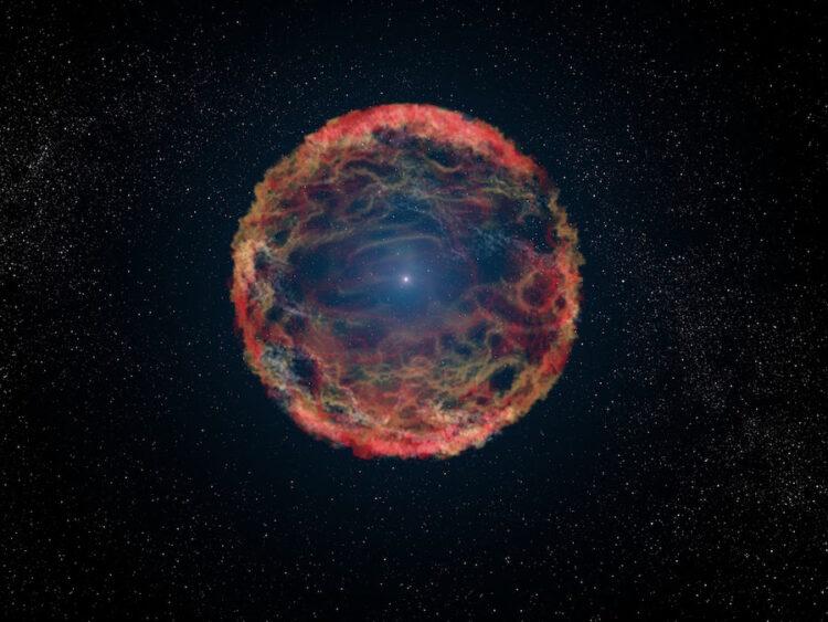 Nesta concepção artística de uma supernova, uma camada expansiva de poeira e gás é explodida para fora, longe do núcleo denso e branco da estrela. A maioria das supernovas explode apenas uma vez, o que acaba com a vida delas para sempre. No entanto, a iPTF14hls parece ter sido supernova duas vezes em apenas 60 anos. Crédito: NASA/ESA/STSCI/G. Bacon
