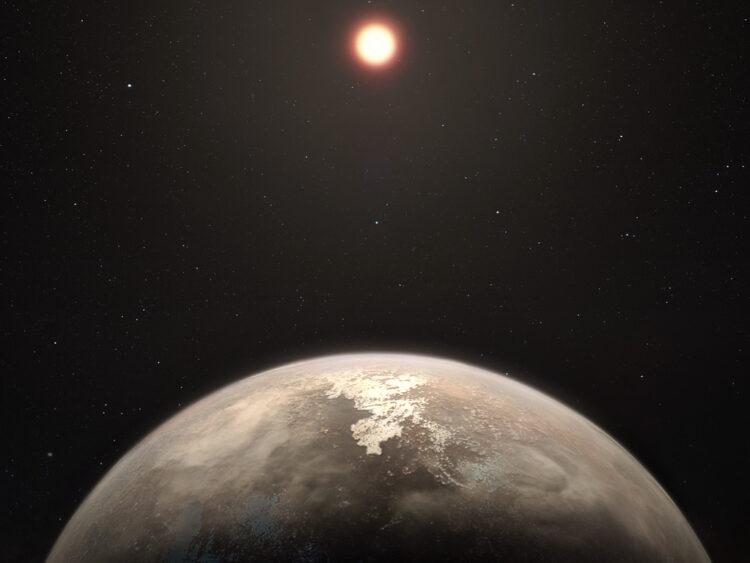 Esta concepção artística mostra o planeta temperado Ross 128 b com a sua estrela anã vermelha progenitora ao fundo. Crédito: ESO