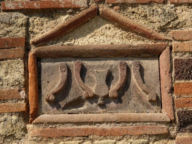 Falos em uma parede de Pompeia.