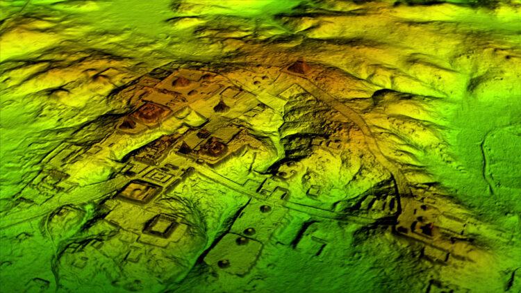 A tecnologia de laser conhecida como LiDAR remove digitalmente o dossel da floresta para revelar as ruínas antigas abaixo, mostrando que as cidades maias, como a Tikal, eram muito maiores que as pesquisas em terra sugeriam. Imagem: Wild Blue Media/National Geographic