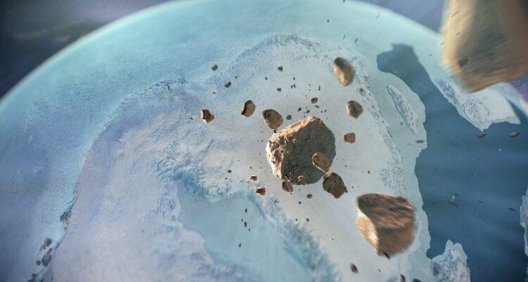 Um asteroide atravessa o espaço em direção à Terra nesta concepção artística de um evento que deixou uma grande cratera no noroeste da Groenlândia em algum momento no passado distante. Crédito: Natural History Museum of Denmark, Cryospheric Sciences Lab/Gsfc/NASA