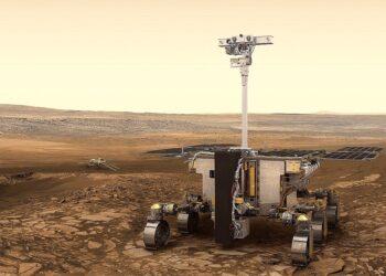 Renderização computacional do veículo espacial Rosalind Franklin explorará a superfície marciana, enquanto a plataforma científica da superfície (estacionária) russa aparece ao fundo. (Crédito: ESA / ATG medialab)