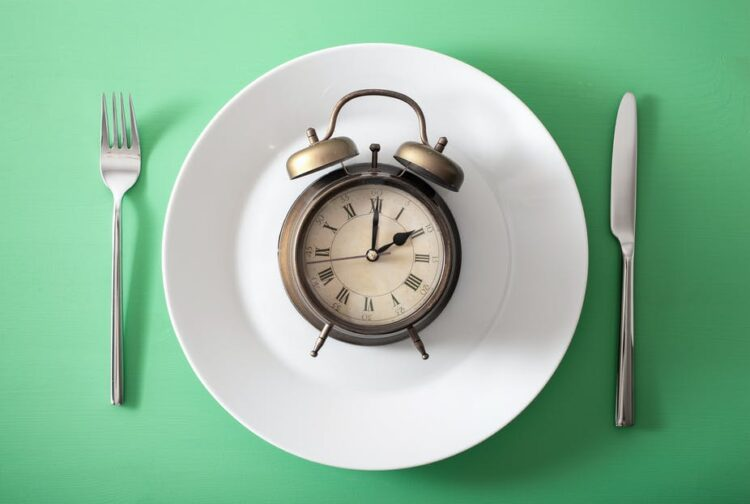 Shutterstock, https://theconversation.com/is-body-weight-affected-by-when-you-eat-heres-what-science-knows-so-far-143303